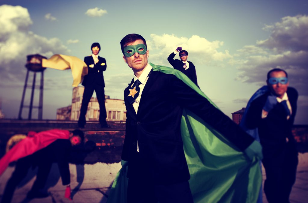 Business people in super hero capes