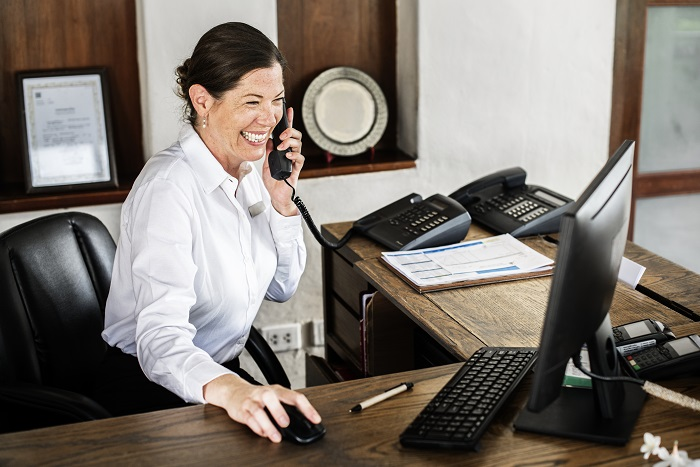 Female receptionist working at the front desk